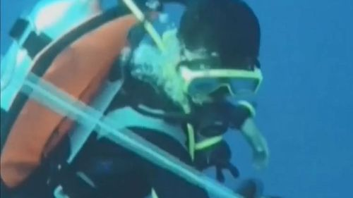 Divers have the grim task of pulling body parts from the water as they search for the missing plane.