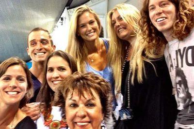 Israeli model Bar Refaeli with Shaun White and Michael Phelps' family.