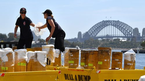 Technicians pack fireworks in preparation for the New Year's Eve celebrations at Glebe Island.