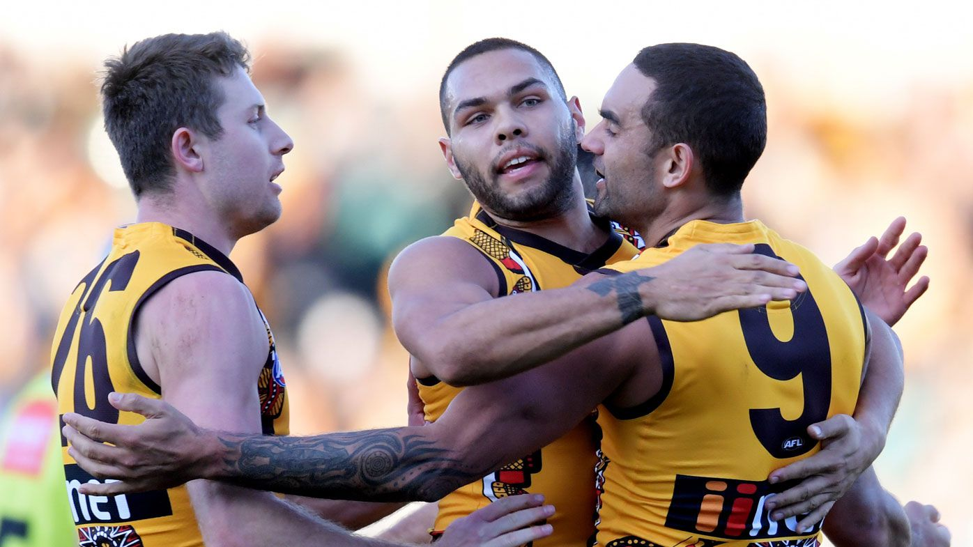 Hawks hold on, edge Port in AFL thriller