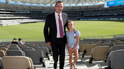 WA premier Mark McGowan at the opening of the new Optus Stadium in Perth, with his daughter Amelie. (AAP)