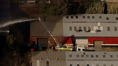 Firefighters struggle to put out a blaze near Penrith, in Sydney's West. (9NEWS)