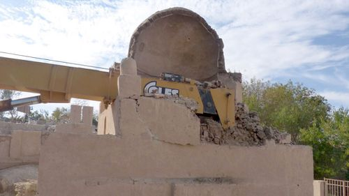 The crane smashed into the centuries-old tomb when it was lifting blocks of sculpted masonry. (AFP)