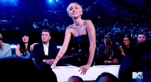 Miley Cyrus watches her proxy walk on stage to accept her MTV Video Music Awards gong for video of the year. (Twitter)