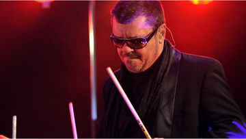 INXS member Tim Farriss is suing a Sydney boat chartering company after his finger was severed in 2015.