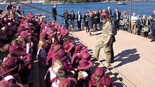 Prince Harry greets schoolchildren at the Opera House. (Kensington Palace)