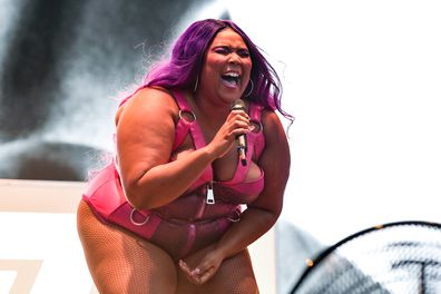 Lizzo, on stage, singing