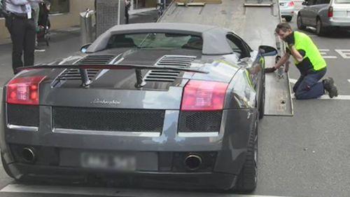 A Lamborghini is among the items seized.