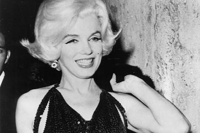 The legendary bombshell had a history of illness and substance abuse, but when she was found dead at age 36, her death was initially ruled as a suicide.<p>Murder conspiracy theories involving the CIA, Mafia, and <b>John</b> and <b>Robert Kennedy</b> circulated, and it was reported that the last person she had called was the President.