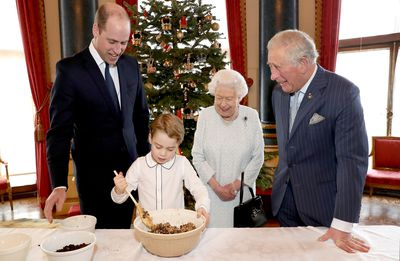 Adorable new photos show Prince George baking with William, Charles and the Queen