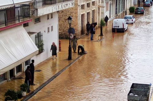 Torrential rain has reached the capital of Greece despite word the weather had lost force and moved east.