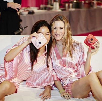 Lily Aldridge and Behati Prinsloo snap photos while lounging backstage. (Instagram/@victoriassecret)