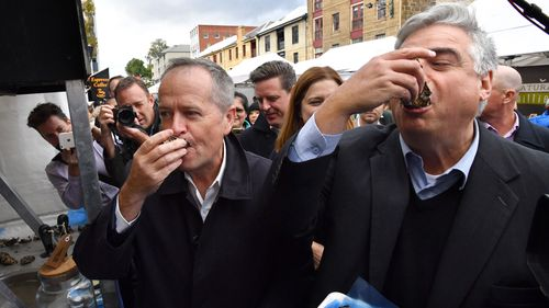 Bill Shorten eating an oyster in Tasmania.