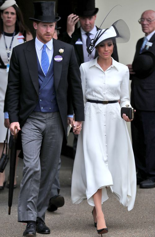 The new royal wore a hat by go-to milliner Philip Treacy, coupled with a fresh and floaty white Givenchy knee-length dress. Picture: Getty