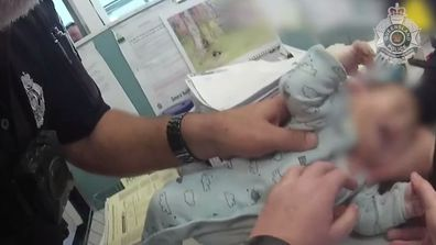 The 10-week-old baby arrive unresponsive in his mother's arms at the Queensland police station.