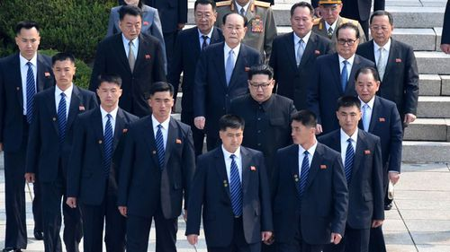 Kim was flanked by security personnel during peace talks with South Korea. (AAP)