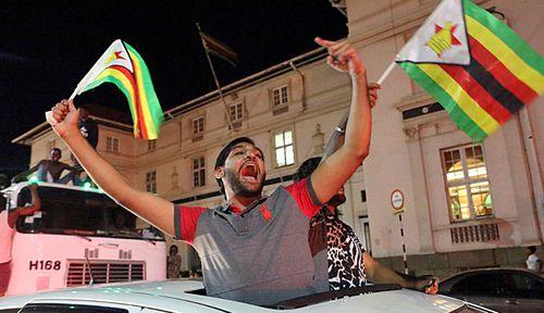 Zimbabwe's public celebrated the end of Robert Mugabe's grip on power. (Photo: AP).