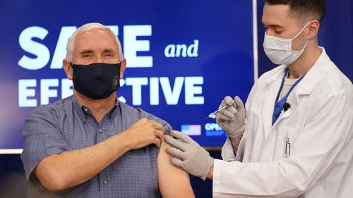 Vice President Mike Pence receives a Pfizer-BioNTech COVID-19 vaccine shot at the Eisenhower Executive Office Building on the White House complex, Friday, Dec. 18, 2020, in Washington