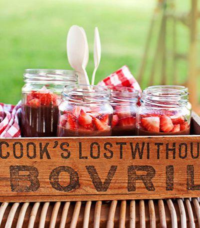 Rich chocolate pots with orange and vanilla marinated strawberries