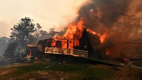 A home lost to a bushfire on Hassall Road in Buxton, near where the two firefighters were killed.
