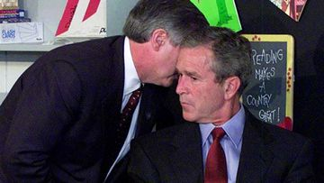 "White House Chief of Staff Andy Card hurries over and whispers to President George W. Bush: ""America is under attack."""