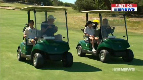 Woods zoomed around the course with Hugo and Jemima on golf buggies today.