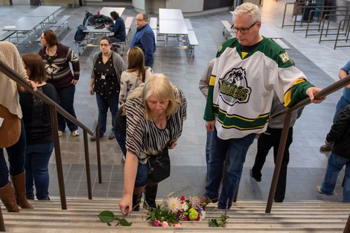 Mourners leave tributes at the Humboldt arena. (AP)