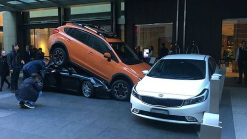Oops! A valet parker in Sydney has a disaster outside the Hyatt Regency.