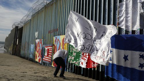 The US-Mexico border wall featured prominently in Mr Trump's speech.