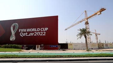 FIFA World Cup 2022 signage next to a bubilding site in Doha, Qatar.