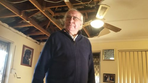 John Green said his wife was lucky that the back of her chair was higher than her head, which helped block the falling debris. (9NEWS)