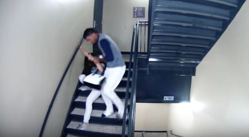 Vasquez then drags the woman down the stairs by her hair. (Supplied)