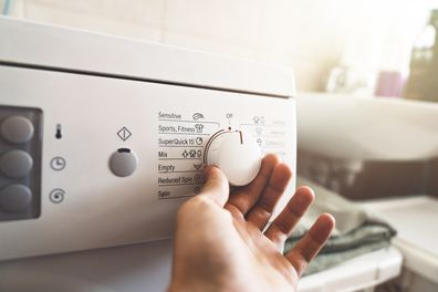 Man preparing the washing machine to start working
