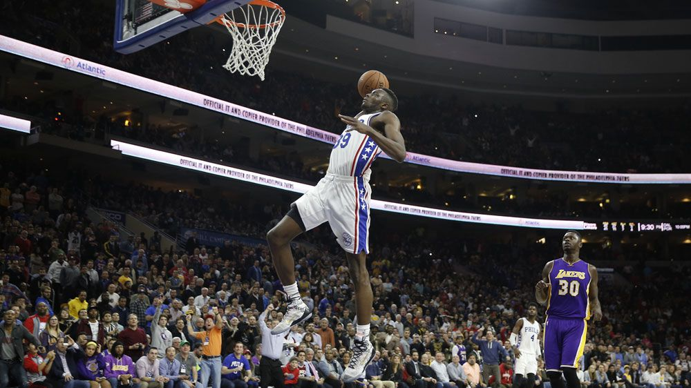 Jerami Grant soars for a dunk against the Lakers. (AAP)