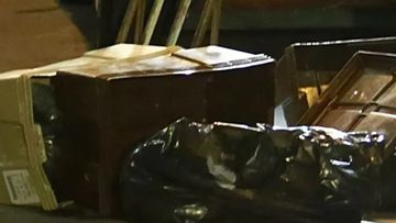The boy's remains were found  in bags and crates being pushed on a delivery trolley .