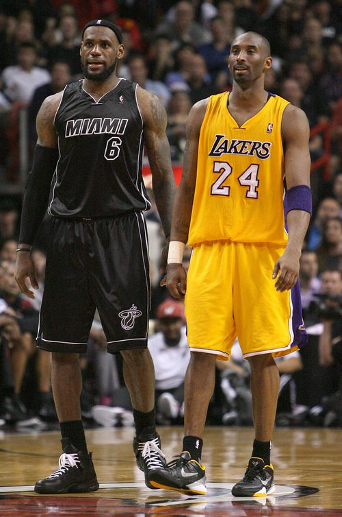 In this 2012 photo, Miami Heat's LeBron James and Los Angeles Lakers' Kobe Bryant look on during the third quarter of an NBA basketball game in Miami.