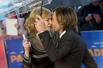 Aww, a kiss in the rain.