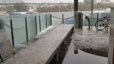 Hail on a ferry stop on the Brisbane river. (Jared Stagg)