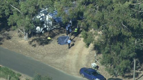 Police are yet to officially name the victims, but believe they were residents of the property. (9NEWS)