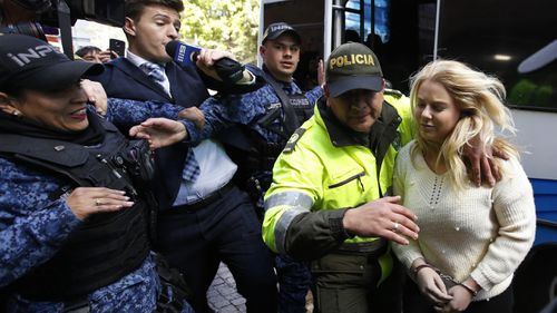 Cassie Sainsbury was escorted by police into a Bogota court this morning. (AAP)