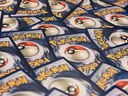 Pokemon cards laid out with the logo facing out.