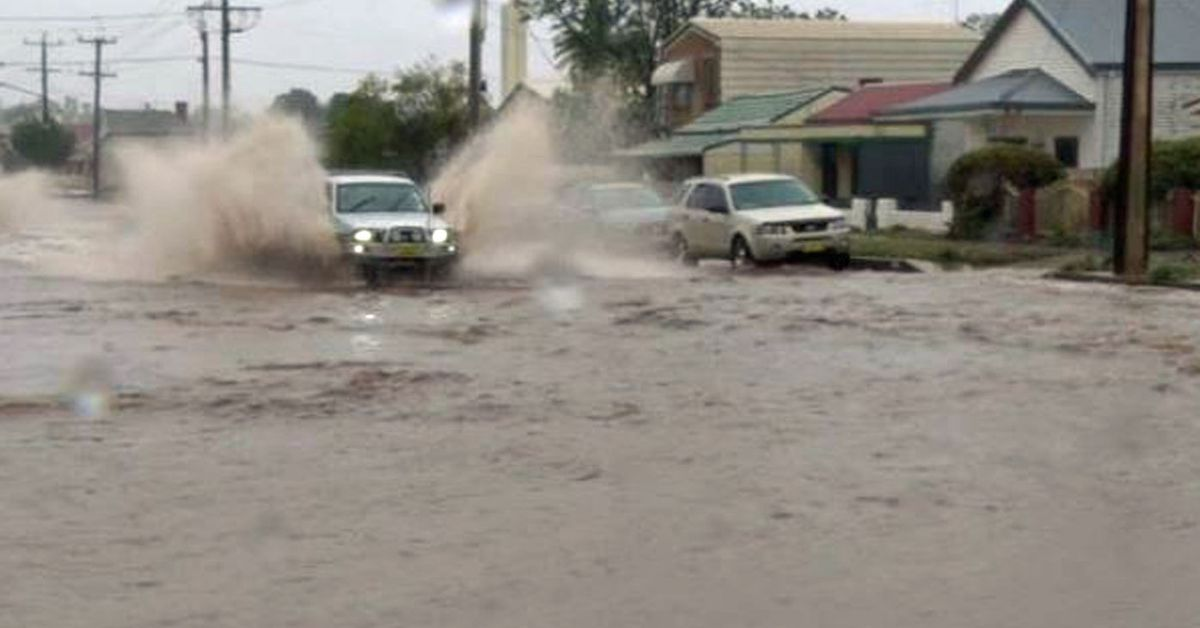 Broken Hill inundated with a month's worth of rain in just 15 minutes – 9News