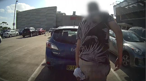 Dashcam footage shows the alleged offender lurking behind parked cars waiting for the right moment to pounce on an unsuspecting Sandra in the Eastgardens parking lot.