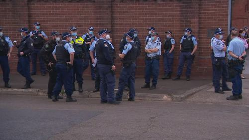 Police gather early this morning near Sydney city.
