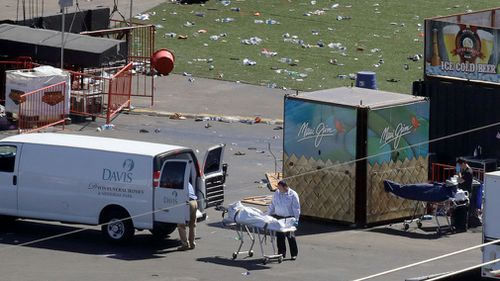 Investigators load a truck with bodies from the scene of the mass shooting. (AP)