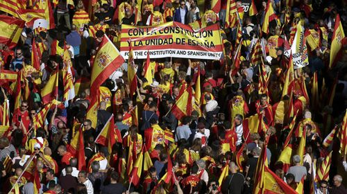 Spanish PM vows to fight Catalan breakaway as huge rally forms