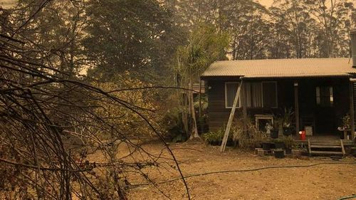 Paul Sekfy's home, which he joked was saved by the 'heroes and milk sneaks' of Urunga RFS.