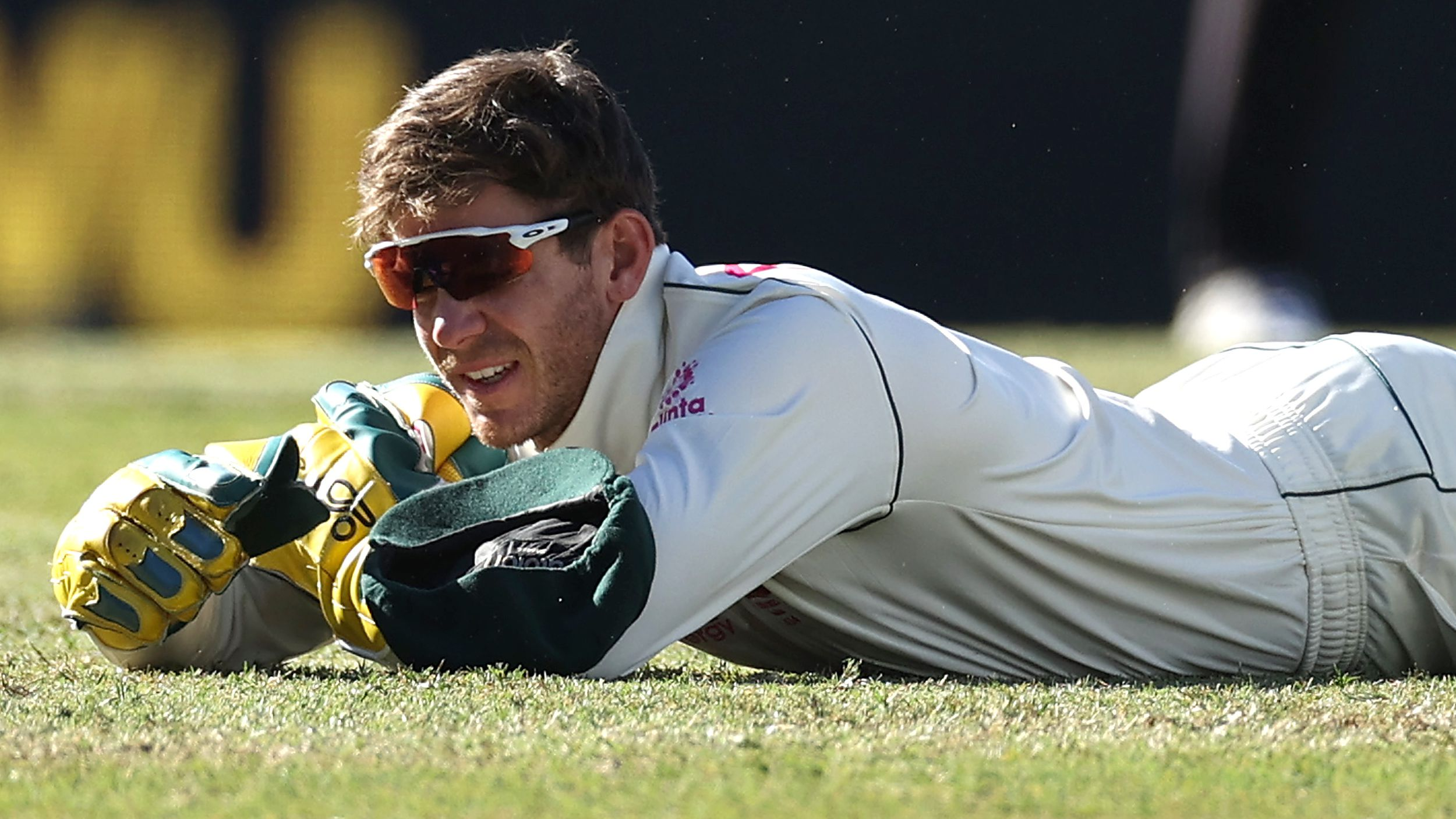 Tim Paine of Australia reacts after dropping a catch off Hanuma Vihari of India.