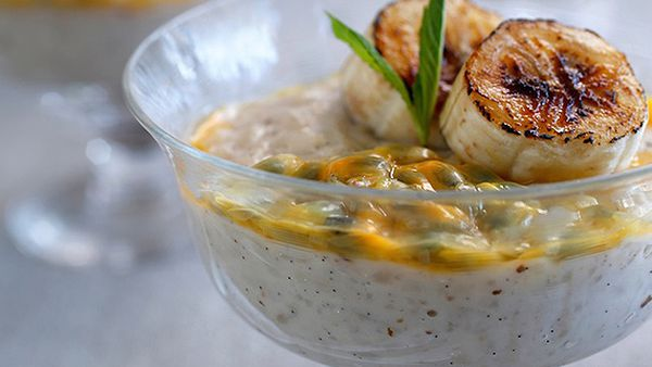 Warm rice pudding with caramelised banana and fresh passionfruit