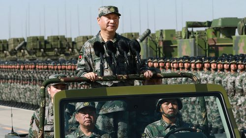 "President Xi Jinping: ""We need to build a strong people's military more than any other time in history"" (Li Gang/Xinhua via AP)."